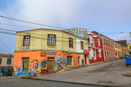 strret: VALPARAISO, CHILE - May 15, 2016: Colourful street art decorating houses in the UNESCO World Heritage port city of Valparaiso in Chile.