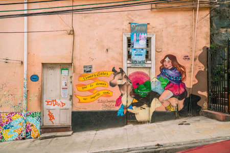 VALPARAISO, CHILE - May 16, 2016: Colourful street art decorating houses in the UNESCO World Heritage port city of Valparaiso in Chile.