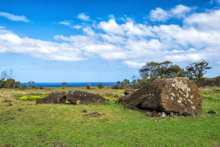 moai: Moai statues in the Rano Raraku Volcano in Easter Island, Chile with blue sky