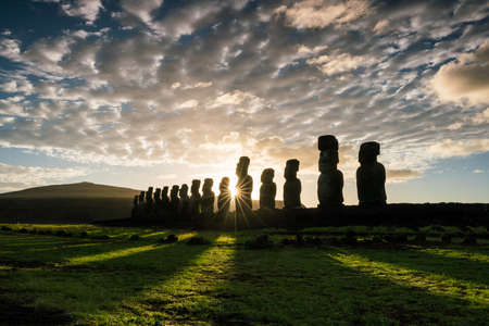 Silhouette shot of Moai statues in Easter Island, Chile sunrise
