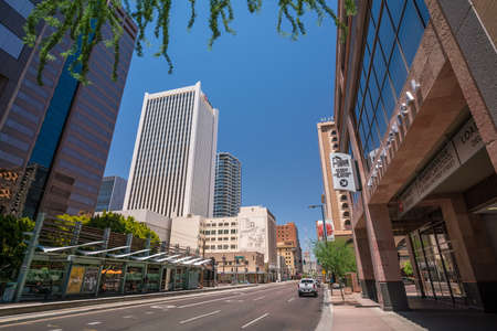 uptown: PHOENIX, AZ - JULY 16, 2016: Sunny  day and clear blue sky above business center and tall skyscrapers in downtown capital city of Phoenix, Arizona on July 16, 2016