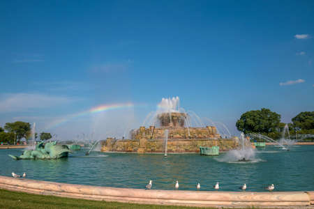 buckingham: Very old Buckingham fountain in Grant Park, Chicago, USA with a rainbow