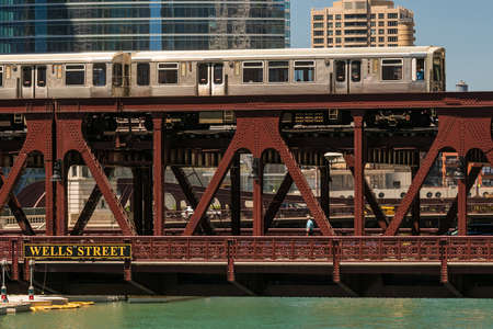 midwest usa: Train in downtown Chicago and a vintage steel bridge Stock Photo
