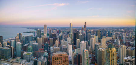 Aerial view of Chicago downtown skyline at sunset from high above.
