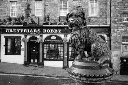 bobby: EDINBURGH, SCOTLAND -DEC 10: A statue of Greyfriars Bobby in Edinburgh on December 10, 2015. Bobby was a dog who supposedly spent 14 years by the grave of his owner until he died in 1872.