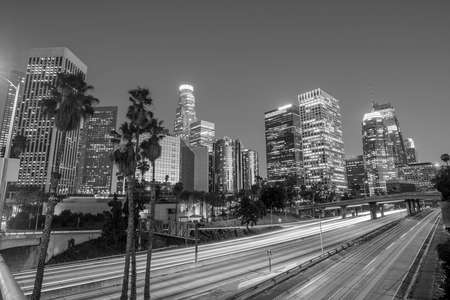 Downtown Los Angeles skyline during rush hour at twilight