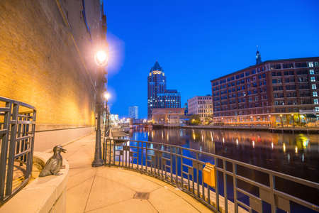 Downtown skyline with Buildings along the Milwaukee River at night, in Milwaukee, Wisconsin. Stock Photo