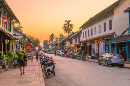 Street in old town Luang Prabang, Laos at sunset 写真素材