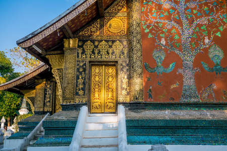 Details shot of Wat Xieng Thong, the most popular temple in Luang Pra bang, Laos Stock Photo