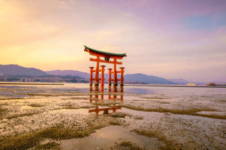 The floating gate of Itsukushima Shrine at sunset in Miyajima, Hiroshima, Japan