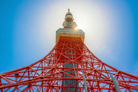 Tokyo tower with sun star and blue sky in Japan Stock Photo