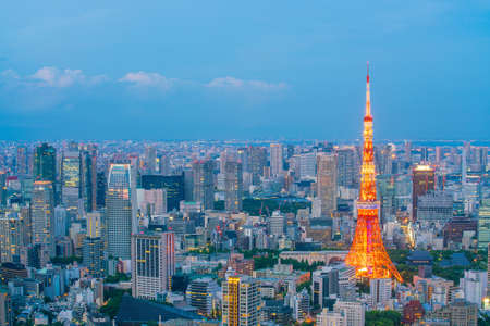 Tokyo skyline  with Tokyo Tower at twilight in Japan Editorial