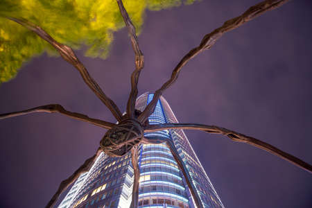 TOKYO, JAPAN - JUNE 03: Maman - a spider sculpture by Louise Bourgeois, situated at the base of Mori tower building in Roppongi Hills on June 3, 2017