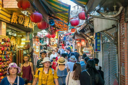 local 27: JIUFEN,TAIWAN - JULY 27: Local and tourist are walking and shopping at Jiufen old street in Ruifang district,Taiwan on July 27, 2017. Editorial