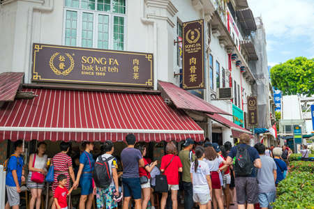 SINGAPORE - AUGUST 9: People waiting in front of famous Song Fa bak kut teh in Singapore on August 9, 2017