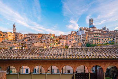 Downtown Siena skyline in Italy with blue sky Stock Photo