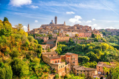 Downtown Siena skyline in Italy with blue sky Stock Photo