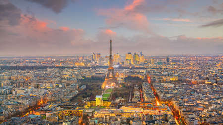 Skyline of Paris with Eiffel Tower at sunset in France from top view