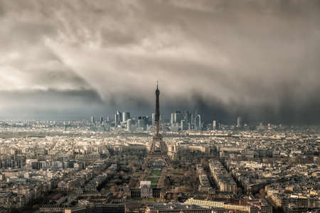 Skyline of Paris with Eiffel Tower with snow storm in France from top view