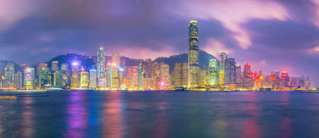 Hong Kong city skyline in China panorama from across Victoria Harbor.