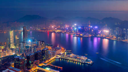 Hong Kong city skyline with Victoria Harbor view at twilight from top view Stock Photo