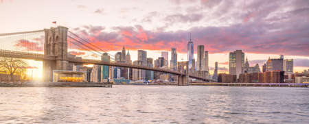 Beautiful sunset over brooklyn bridge in New York City, United States
