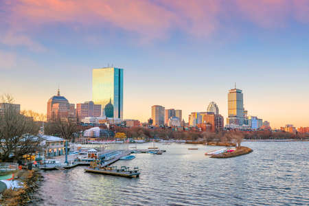 Panorama view of Boston skyline with skyscrapers over water at twilight in United States