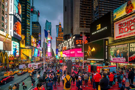 NEW YORK CITY - March 9: Times Square area with neon art and commerce, an iconic street of Manhattan on March 3, 2018 in New York City , United States
