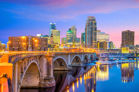 Minneapolis downtown skyline in Minnesota, USA at sunset 写真素材