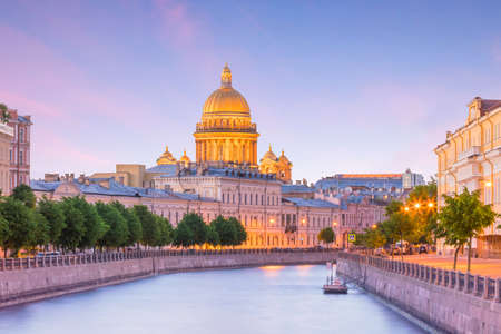 Saint Isaac Cathedral across Moyka river in St. Petersburg, Russia Stock Photo - 105180762