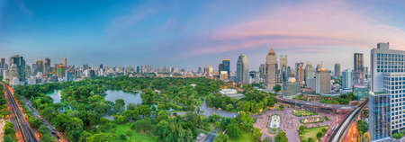 Downtown Bangkok city skyline with Lumpini park  from top view in Thailand at sunset