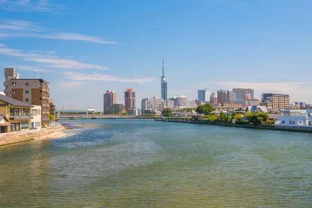 Fukuoka city skyline in Japan with blue sky Stock Photo