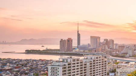 Fukuoka city skyline in Japan at sunset Stock Photo - 105627102
