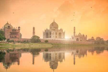 Panoramic view of Taj Mahal at sunset with reflection in Agra, India.