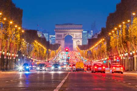 Arc de Triumph in Paris, France at twilight 写真素材