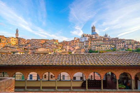 Downtown Siena skyline in Italy with blue sky
