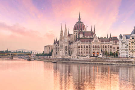 Parliament building over delta of Danube river in Budapest, Hungary at sunset Stock Photo