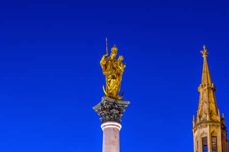 Steeple of the Peace Column with famous golden Angel of Peace statue in Munich, Germany