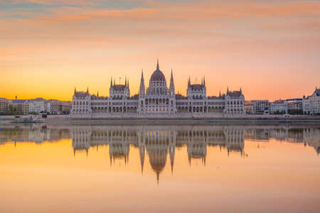 Parliament building over delta of Danube river in Budapest, Hungary at sunset Editorial