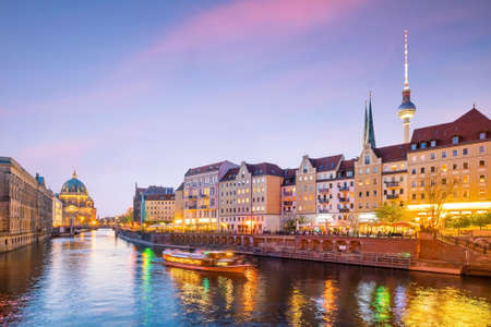 Berlin skyline with Berlin Cathedral (Berliner Dom) and Spree river at sunset twilight, in Germany