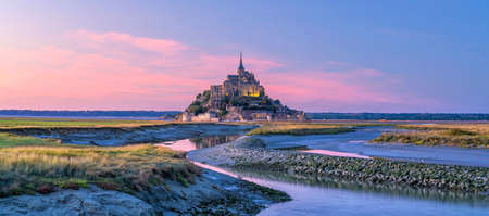 Mont Saint-Michel at sunset twilight in Normandy, northern France