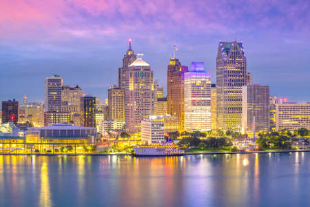 Detroit skyline in Michigan, USA at sunset shot from Windsor, Ontario Canada