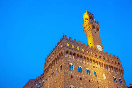 Palazzo Vecchio in downtown Florence city in Tuscany Italy at twilight