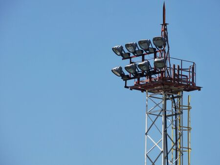 High-mast lighting against a cloudless sky.
