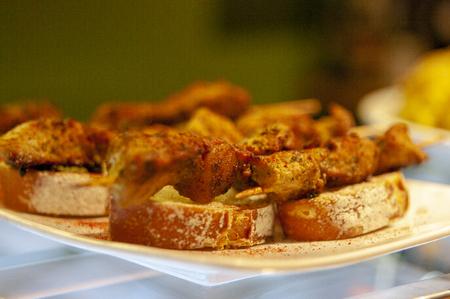 Spanish tapas. Pinchos morunos on bread. Montaditos