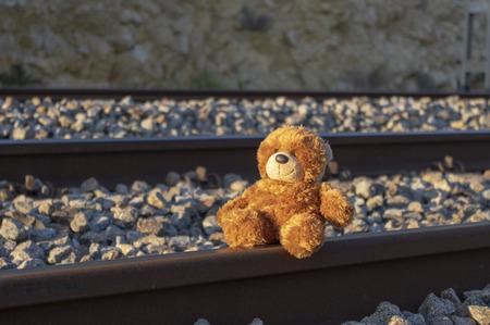 Teddy bear alone on railway 免版税图像