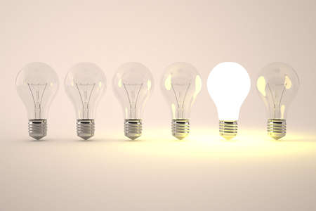 among: one light bulb is on, while the other off. picturing one brilliant idea among the other