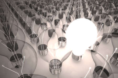 one light bulb is on, while the other off. picturing one brilliant idea among the other photo