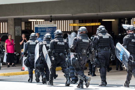 Charlottesville, Virginia USA August 12, 2017 State Police wearing full riot gear form in front of East Market Street Parking Garage after fight clears up to secure area.