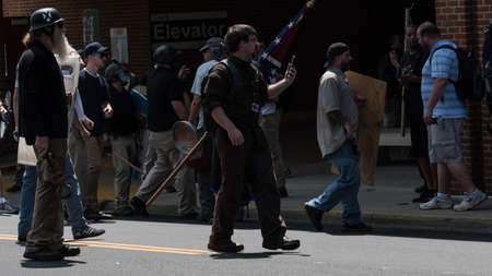 Charlottesville, Virginia USA August 12, 2017 Men going towards DeAndre Harris fight at the East Market Street Parking Garage after poilice dissolve UTR rally in support of confederate statue